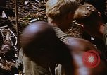 Image of American soldiers at captured VC tunnel complex Vietnam, 1968, second 20 stock footage video 65675052380