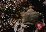 Image of American soldiers at captured VC tunnel complex Vietnam, 1968, second 23 stock footage video 65675052380
