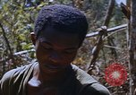 Image of American soldiers at captured VC tunnel complex Vietnam, 1968, second 25 stock footage video 65675052380