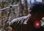 Image of American soldiers at captured VC tunnel complex Vietnam, 1968, second 26 stock footage video 65675052380