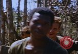 Image of American soldiers at captured VC tunnel complex Vietnam, 1968, second 27 stock footage video 65675052380