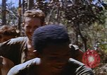 Image of American soldiers at captured VC tunnel complex Vietnam, 1968, second 28 stock footage video 65675052380