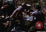 Image of American soldiers at captured VC tunnel complex Vietnam, 1968, second 43 stock footage video 65675052380