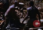 Image of American soldiers at captured VC tunnel complex Vietnam, 1968, second 44 stock footage video 65675052380