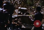 Image of American soldiers at captured VC tunnel complex Vietnam, 1968, second 47 stock footage video 65675052380