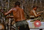 Image of American soldiers at captured VC tunnel complex Vietnam, 1968, second 54 stock footage video 65675052380