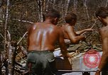 Image of American soldiers at captured VC tunnel complex Vietnam, 1968, second 55 stock footage video 65675052380