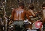 Image of American soldiers at captured VC tunnel complex Vietnam, 1968, second 56 stock footage video 65675052380