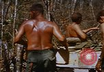 Image of American soldiers at captured VC tunnel complex Vietnam, 1968, second 57 stock footage video 65675052380