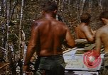Image of American soldiers at captured VC tunnel complex Vietnam, 1968, second 58 stock footage video 65675052380