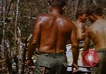 Image of American soldiers at captured VC tunnel complex Vietnam, 1968, second 59 stock footage video 65675052380