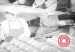 Image of war production workers at Douglas Aircraft Long Beach California USA, 1942, second 1 stock footage video 65675052406