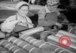 Image of war production workers at Douglas Aircraft Long Beach California USA, 1942, second 15 stock footage video 65675052406