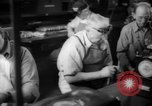 Image of war production workers at Douglas Aircraft Long Beach California USA, 1942, second 39 stock footage video 65675052406