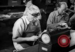 Image of war production workers at Douglas Aircraft Long Beach California USA, 1942, second 48 stock footage video 65675052406