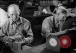 Image of war production workers at Douglas Aircraft Long Beach California USA, 1942, second 52 stock footage video 65675052406