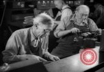 Image of war production workers at Douglas Aircraft Long Beach California USA, 1942, second 55 stock footage video 65675052406