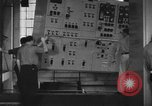 Image of Electricity production and factory production during World War 2 United States USA, 1941, second 3 stock footage video 65675052444