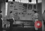 Image of Electricity production and factory production during World War 2 United States USA, 1941, second 7 stock footage video 65675052444