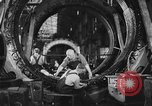 Image of Electricity production and factory production during World War 2 United States USA, 1941, second 13 stock footage video 65675052444