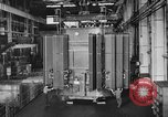 Image of Electricity production and factory production during World War 2 United States USA, 1941, second 18 stock footage video 65675052444