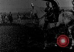 Image of British infantry soldiers firing artillery World War 1 Europe, 1916, second 56 stock footage video 65675052474
