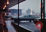 Image of water on streets Rapid City South Dakota USA, 1972, second 46 stock footage video 65675052499