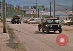 Image of convoy of National Guard trucks Rapid City South Dakota USA, 1972, second 14 stock footage video 65675052523