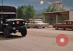 Image of convoy of National Guard trucks Rapid City South Dakota USA, 1972, second 18 stock footage video 65675052523