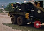 Image of convoy of National Guard trucks Rapid City South Dakota USA, 1972, second 23 stock footage video 65675052523