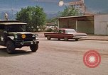 Image of convoy of National Guard trucks Rapid City South Dakota USA, 1972, second 27 stock footage video 65675052523