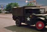 Image of convoy of National Guard trucks Rapid City South Dakota USA, 1972, second 28 stock footage video 65675052523
