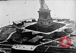 Image of U.S. Navy Class C airships over Statue of Liberty New York United States USA, 1918, second 14 stock footage video 65675052579