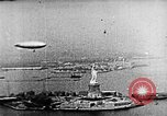 Image of U.S. Navy Class C airships over Statue of Liberty New York United States USA, 1918, second 27 stock footage video 65675052579