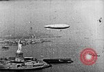 Image of U.S. Navy Class C airships over Statue of Liberty New York United States USA, 1918, second 34 stock footage video 65675052579