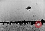 Image of Parachutist jumps from airship New York United States USA, 1918, second 20 stock footage video 65675052580