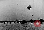 Image of Parachutist jumps from airship New York United States USA, 1918, second 21 stock footage video 65675052580