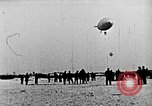 Image of Parachutist jumps from airship New York United States USA, 1918, second 22 stock footage video 65675052580