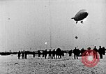 Image of Parachutist jumps from airship New York United States USA, 1918, second 25 stock footage video 65675052580
