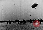 Image of Parachutist jumps from airship New York United States USA, 1918, second 27 stock footage video 65675052580