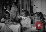 Image of Myrna Loy with polio victims Washington DC USA, 1944, second 33 stock footage video 65675052630
