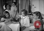 Image of Myrna Loy with polio victims Washington DC USA, 1944, second 34 stock footage video 65675052630