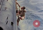 Image of US submarine rescues Japanese survivors at sea Pacific Ocean, 1945, second 13 stock footage video 65675052639