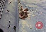 Image of US submarine rescues Japanese survivors at sea Pacific Ocean, 1945, second 14 stock footage video 65675052639