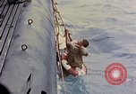 Image of US submarine rescues Japanese survivors at sea Pacific Ocean, 1945, second 16 stock footage video 65675052639