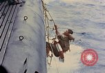 Image of US submarine rescues Japanese survivors at sea Pacific Ocean, 1945, second 18 stock footage video 65675052639