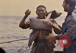 Image of US submarine rescues Japanese survivors at sea Pacific Ocean, 1945, second 22 stock footage video 65675052639