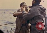 Image of US submarine rescues Japanese survivors at sea Pacific Ocean, 1945, second 23 stock footage video 65675052639