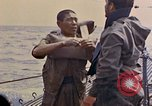 Image of US submarine rescues Japanese survivors at sea Pacific Ocean, 1945, second 25 stock footage video 65675052639