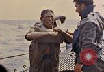 Image of US submarine rescues Japanese survivors at sea Pacific Ocean, 1945, second 26 stock footage video 65675052639